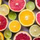 flat lay photography of sliced pomegranate, lime, and lemon